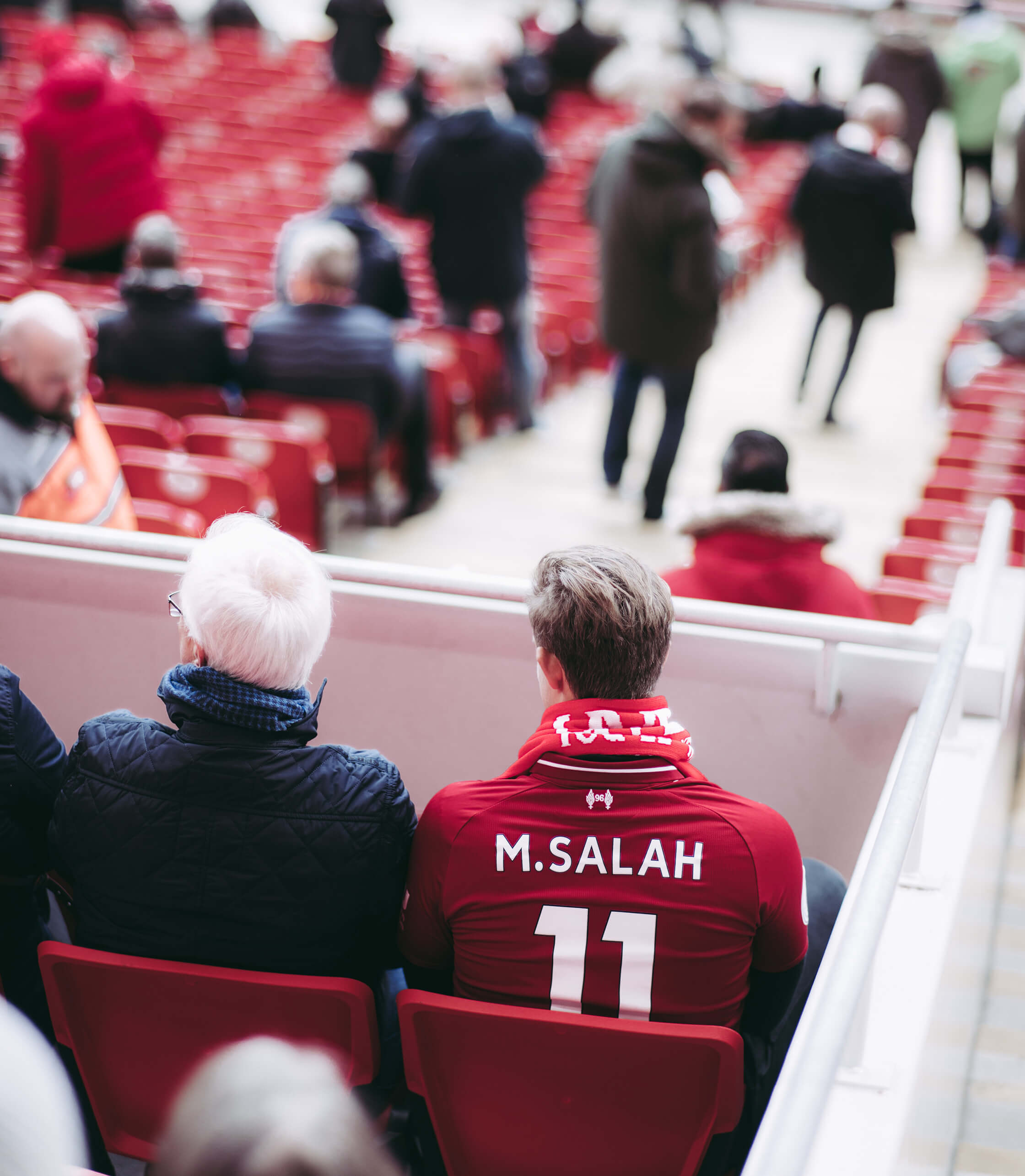 Football Fan In Liverpool Kit In Stadium