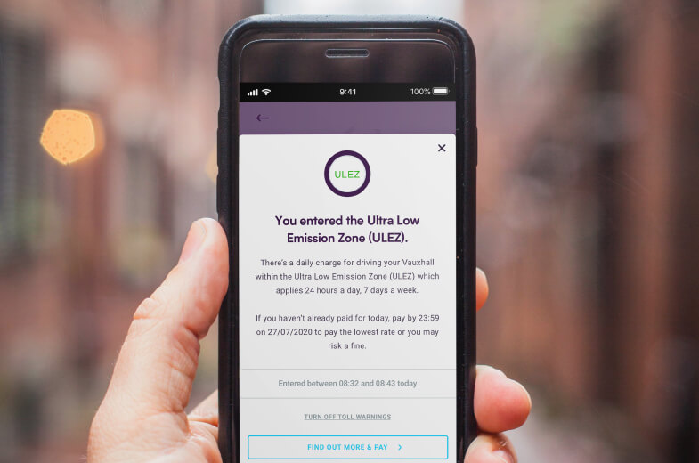 By Miles app Ultra Low Emissions Zone London Message on phone
