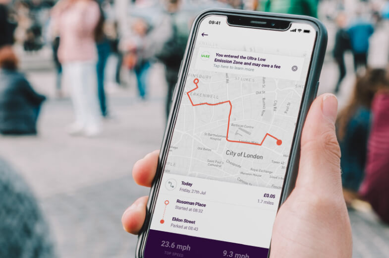 By Miles app Ultra Low Emissions Zone London Warning in Hand